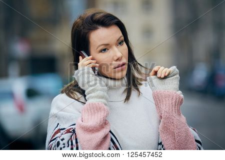 Attractive woman talking over her mobile phone