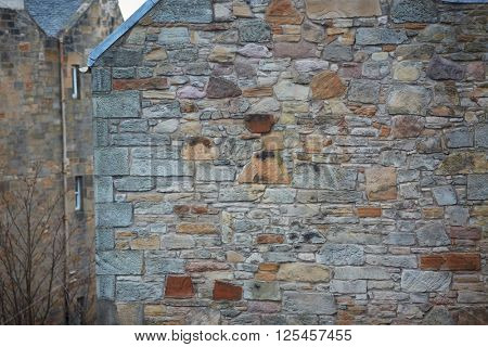 Stone wall, side of the old building