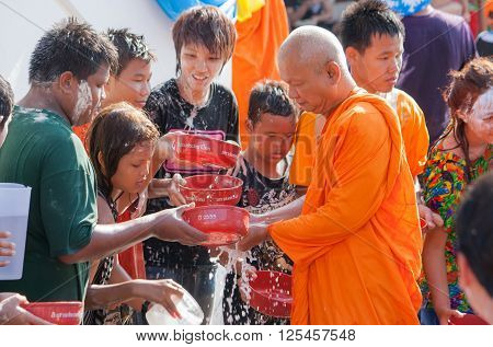 Nonthaburi - April 15: Thailand Buddhist people of all ages. Merit bathing tradition passed down by the monks in the festival. Temple Poramai Jihad Bhargava Koh Kret Thailand 2011/4/15