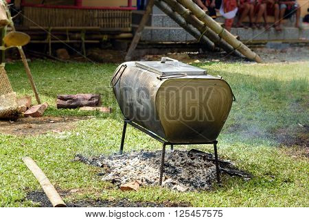 Big cauldron with cooking buffalo meat on the fire at funeral ceremony. In Toraja the funeral ritual is the most elaborate and expensive even. Tana Toraja. South Sulawesi Indonesia