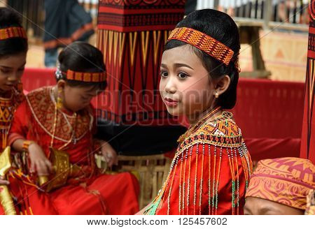 Young Girl In Traditional Clothes At Funeral Ceremony. Tana Toraja