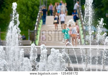 part of fountain and space with people on bridge in Tsaritsyno park. Moskow, Russia.