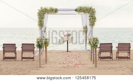 simple style wedding arch and decoration venue setup on tropical beach outdoor beach wedding. Vintage process. ** Note: Visible grain at 100%, best at smaller sizes