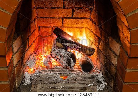 Ash, Coal And Burning Wood In Fireplace