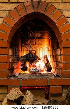 Few Wood And Burnuing Logs Fire In Fireplace