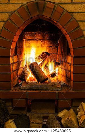 Firewood And Tongues Of Fire In Fireplace