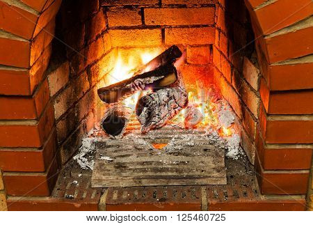Ash, Coal And Burning Firewood In Fireplace
