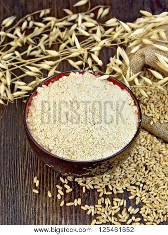 Flour Oat In Bowl With Grain On Board