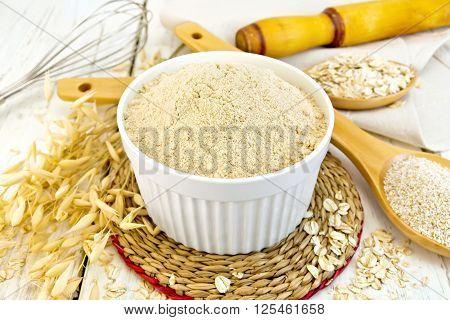 Flour Oat In White Bowl On Light Board