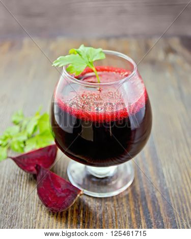 Juice Beet In Wineglass On Board