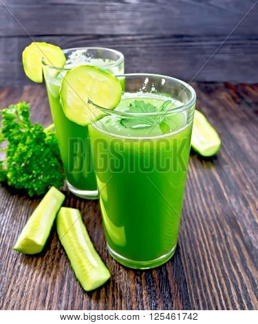 Juice Cucumber In Two Tall Glass On Dark Board