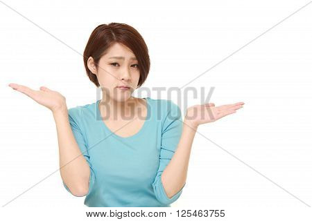 studio shot of Japanese woman confused on white background