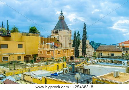 The view on Basalica of Annunciation through the roofs of Nazareth Israel.