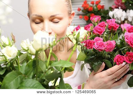 Smell the roses, woman smelling a bouquet of beautiful roses