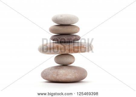 Pile of balancing pebble stones like ZEN stone isolated on white background spa tranquil scene concept