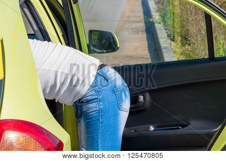 Female Ass Peeking Out Of The Car