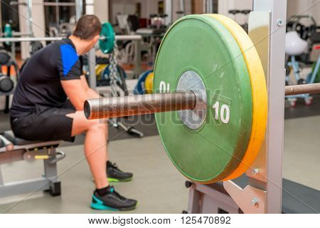 Tired Athlete Resting On A Bench At The Gym