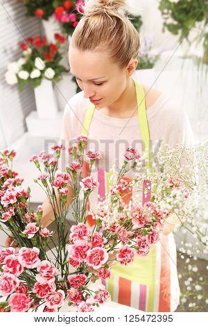 Beautiful cut flowers, a florist arranges medley .