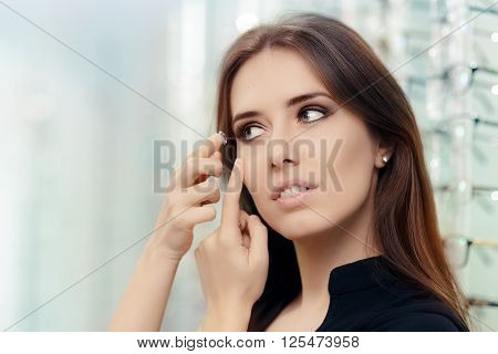 Woman with Cosmetic Colored in Optical Store