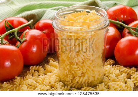 noodle in a storage glass and fresh tomato