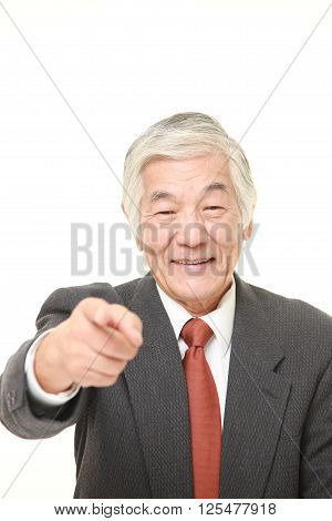 studio shot of senior Japanese businessman decided  on white background