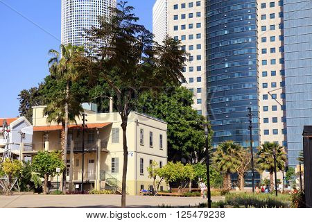 TEL AVIV, ISRAEL - APRIL 7, 2016 : Modern open air commercial center Sarona over skyscrapers of Azrieli Center in Tel Aviv, Israel. Recently open Sarona Market became the most popular place in Tel Aviv.