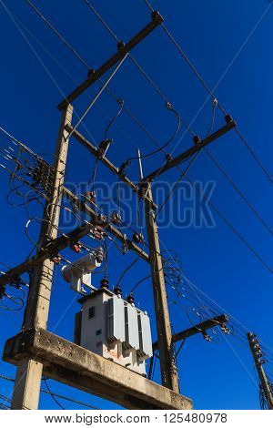 Transformer with protection systems on concrete pole