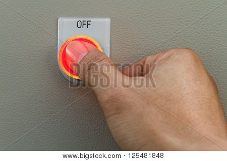Humb touch on red off switch on control panel