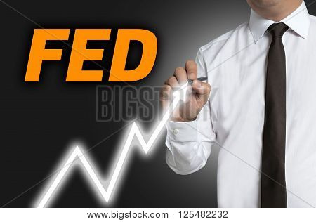 fed trader draws market price on touchscreen.