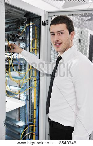 Young It Engeneer In Datacenter Server Room