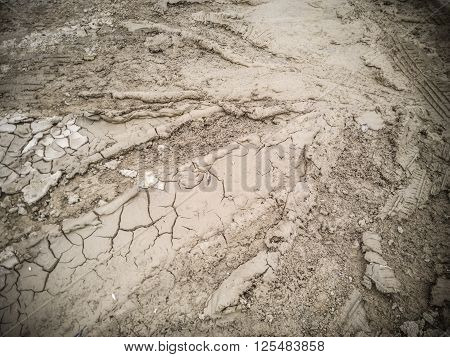 Dry soil with tyre mark on the ground