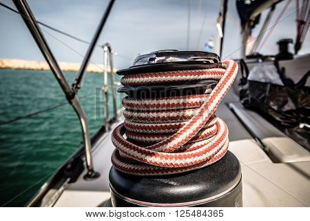 Winch With Red And White Rope On Sailing Boat In The Sea