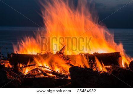 Campfire at twilight on beach.  long exposure.