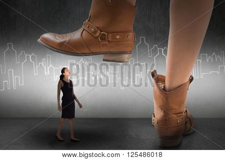 Cowboy boots dancing against hand drawn city plan