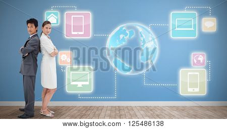 Portrait of business people standing back-to-back against room with wooden floor