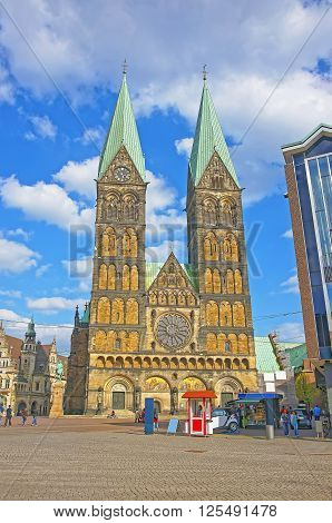 Bremen, Germany - May 1, 2013: Bremen Cathedral in Bremen in Germany. It is also called St Peter Cathedral. It is placed in the Market Square in the city center of Bremen. People nearby