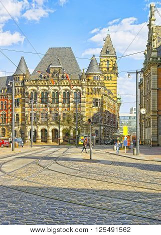 Bremen, Germany - May 1, 2013: Courthouse of Bremen in Germany. It is called Landgericht and placed on Domsheide square in the Old town of Bremen. It is made in the Renaissance style. People nearby