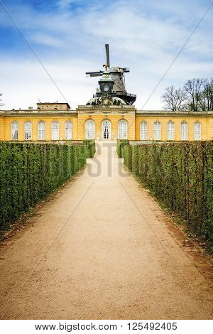 POTSDAM GERMANY - APRIL 30 2013: View on wind mill in Sanssouci Park in Potsdam in Germany. It used to be a summer palace of King of Prussia Frederick the Great.