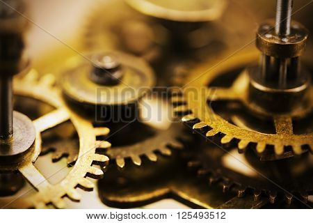 Close Up Of Cogs Inside A Clock
