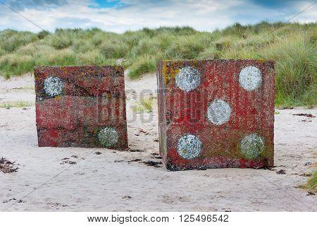 Large concrete dice near Bamburgh Castle England