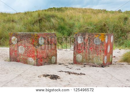 Large concrete dice near Bamburgh Castle England