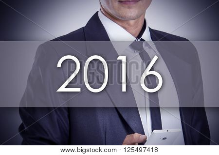 2016 - Young Businessman With Text - Business Concept