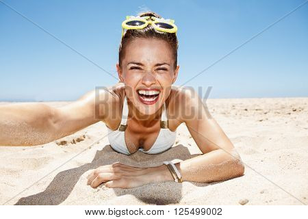 Smiling Woman In Funky Glasses Taking Selfies At Sandy Beach