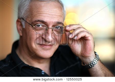 Close-up Portrait Of A Happy Elderly Man