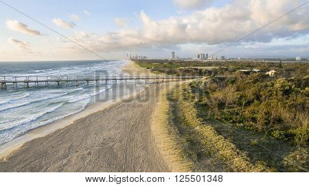 Aerial view of The Spit sand pumping jetty and beach at sunrise. Gold Coast, Australia