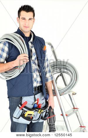 Portrait of an electrician on white background