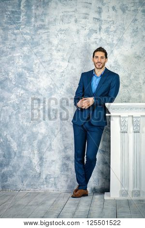 Fashion shot of a handsome man wearing elegant suit. Men's beauty, fashion. Businessman. Full length portrait.