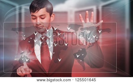 Unsmiling businessman holding and pointing against composite image of server room
