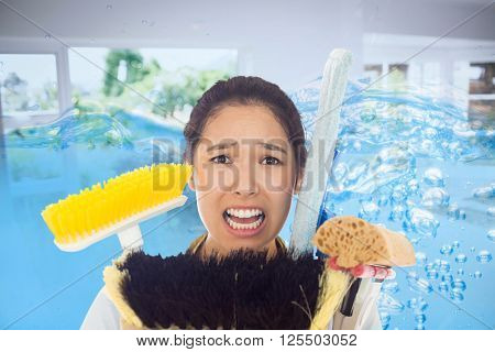 Very stressed woman with cleaning tools against close up on blue sparkling water