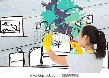 Woman spraying and wiping in rubber gloves against living room sketch with ink splash